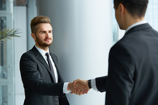Business People. Successful Business Partner Shaking Hands in the office